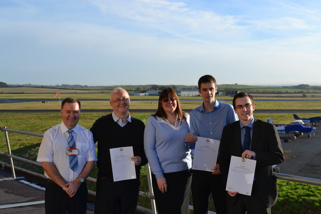 Successful Candidates receiving their SQA certificates (L to R): Steve Thompson (Prestwick Airport), Peter Gaffney (Prestwick Airport), Marion Chandler (C&M Training), Adam McMonagle (Prestwick Airport) and Mathew Wilson (Prestwick Airport)