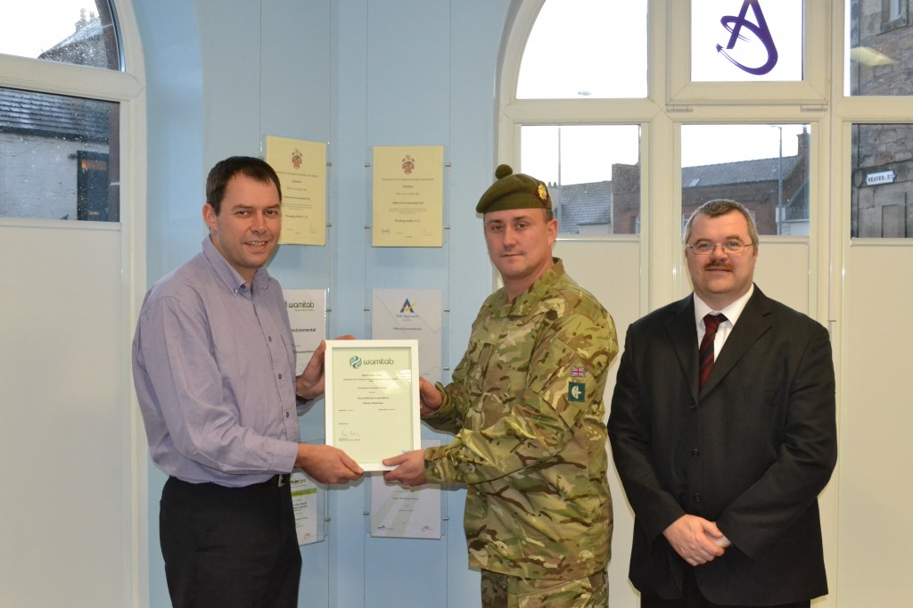 Craig looks on as successful candidate; WO2 W Robertson receives his Diploma in Facilities Management Practice from Albion Environmental Ltd's Alasdair Meldrum at a ceremony in Ayr.